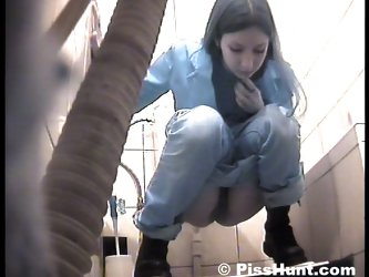 Cute girl peeing straight onto voyeur camera