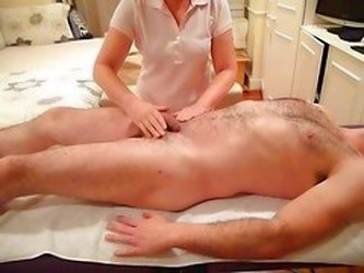 Female Massage Therapist Perform...