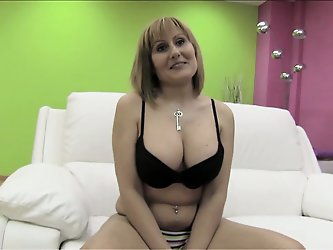Nuria is a horny Spanish MILF with an...